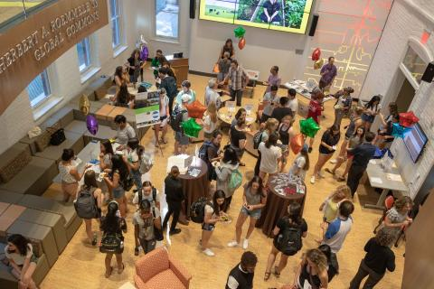 An overhead shot of the event showing students and faculty interacting
